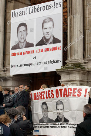 """Florence Aubenas, Gerard Taponier, Arlette Taponier People gather in support of French TV journalists Herve Ghesquiere and Stephane Taponier, who were kidnapped a year ago east of Kabul, Afghanistan, in front of Paris city hall, . The banner in back reads: """"One year! Let us free them and their Afghan fixers"""