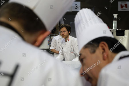 """Rasmus Kofoed Rasmus Kofoed, of Denmark, prepares food during the """"Bocuse d'Or"""" (Golden Bocuse) trophy, at the 13th World Cuisine contest, in Lyon, central France, . The contest, a sort of world cup of cuisine, was started in 1987 by Lyon chef Paul Bocuse to reward young international culinary talents"""