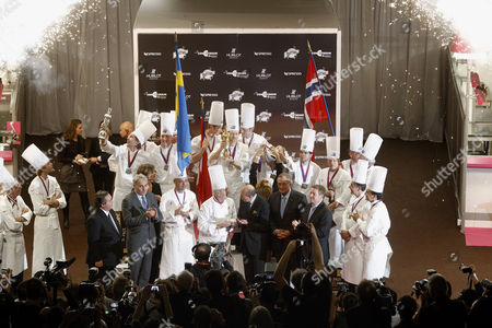 """Rasmus Kofoed Rasmus Kofoed of Denmark, center, holds his trophy as he celebrates on the podium with his teammates after winning the """"Bocuse d'Or"""" (Golden Bocuse) trophy, at the 13th World Cuisine contest, in Lyon, central France, ahead the Sweden's team, left, and the Norway's team, right, . The contest, a sort of world cup of the cuisine, was started in 1987 by Lyon chef Paul Bocuse to reward young international culinary talents"""