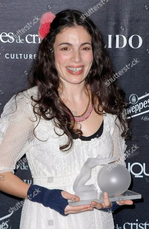 Yael Naim French-Israeli singer and songwriter Yael Naim poses with her Crystal Globes award for best singer 2010 during the awards ceremony, in Paris