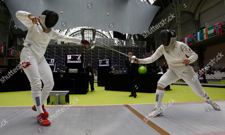 Stock Picture of Tiffany Geroudet, Joanna Guy Swizerland's Tiffany Geroudet, left, plays Canada's Joanna Guy in the women's epee single's category group of 64 during the fencing World Championships in Paris
