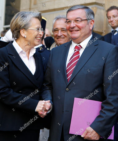 Michele Alliot-Marie, Michel Mercier Outgoing France's Justice Minister, Michele Alliot-Marie, left, welcomes newly named Justice Minister, Michel Mercier, during the handover ceremony in Paris, . President Nicolas Sarkozy pulled together a new Cabinet on Sunday night with a strong conservative thrust that appears designed to boost the widely disliked president's chances for a second term in 2012
