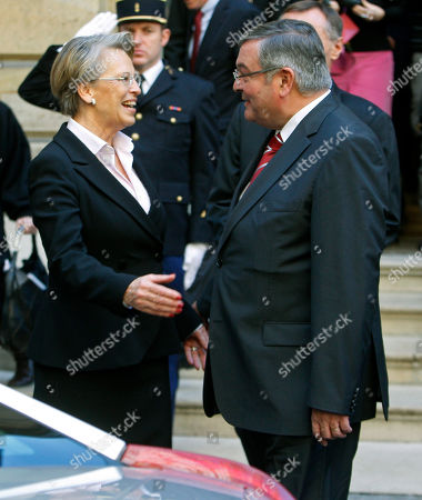 Michele Alliot-Marie, Michel Mercier Outgoing France's Justice Minister, Michele Alliot-Marie, left, bits farewell to newly named Justice Minister, Michel Mercier, during the handover ceremony in Paris, . President Nicolas Sarkozy pulled together a new Cabinet on Sunday night with a strong conservative thrust that appears designed to boost the widely disliked president's chances for a second term in 2012