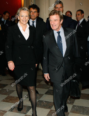 Michele Alliot-Marie, Bernard Kouchner Newly named France's Foreign Minister Michele Alliot-Marie, left, accompanies outgoing Foreign Minister, Bernard Kouchner, after the handover ceremony in Paris, . President Nicolas Sarkozy pulled together a new Cabinet on Sunday night with a strong conservative thrust that appears designed to boost the widely disliked president's chances for a second term in 2012
