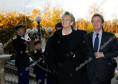 Michele Alliot-Marie, Bernard Kouchner Newly named France's Foreign Minister Michele Alliot-Marie, left, and outgoing Foreign Minister, Bernard Kouchner, arrives for the handover ceremony in Paris, . President Nicolas Sarkozy pulled together a new Cabinet on Sunday night with a strong conservative thrust that appears designed to boost the widely disliked president's chances for a second term in 2012