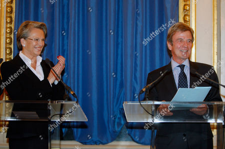 Michele Alliot-Marie, Bernard Kouchner Newly named French Foreign Minister Michele Alliot-Marie, left, applauds, after the speech of outgoing Foreign Minister, Bernard Kouchner, during the handover ceremony in Paris, . President Nicolas Sarkozy pulled together a new Cabinet on Sunday night with a strong conservative thrust that appears designed to boost the widely disliked president's chances for a second term in 2012
