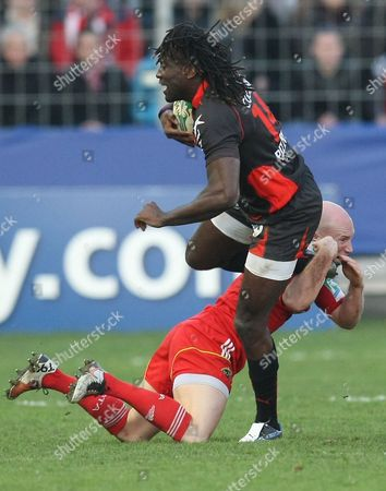 Toulon's Paul Sackey, left, is tackled by Munster's Peter Stringer during their Heineken European Cup rugby match, in Toulon, southeastern France