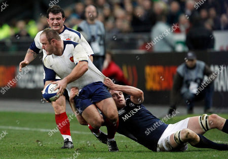 Alastair Kellock, William Servat Scotland's Alastair Kellock, right, tackles France's William Servat during their six nations rugby union match at the Stade de France stadium, in Saint Denis, outside Paris