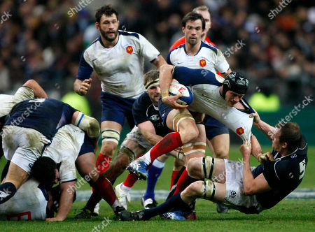 Alastair Kellock, Lionel Nallet France's Lionel Nallet, second right, is tackled by Scotland's Alastair Kellock, right, during his six nations rugby union match at the Stade de France stadium, in Saint Denis, outside Paris, Saturday, Feb. 5, 2011