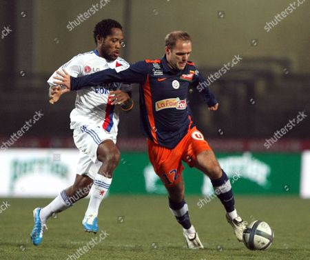 Stock Picture of Olivier Giroud, Jean II Makou Montpellier's French forward Olivier Giroud, right, challenges for the ball with Lyon's Cameroonian midfielder Jean II Makoun, during their League One soccer match, at La Mosson Stadium, in Montpellier, southern France, Saturday, Dec.4, 2010