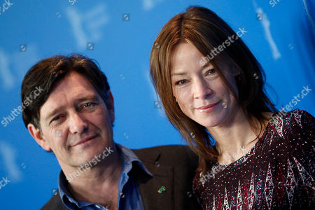 Jenny Schily, Pierre Bokma German actress Jenny Schily, right, and Dutch actor Pierre Bokma pose at a photo-call about the movie Sleeping Sickness during the International Film Festival Berlinale in Berlin on