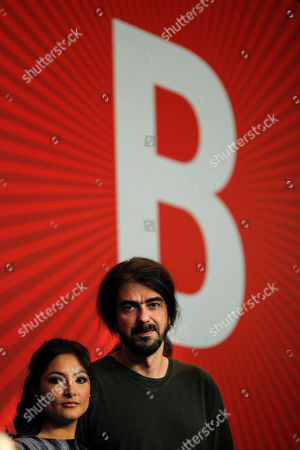 Stock Image of Fernando Leon de Aranoa, Magaly Solier Spanish Director Fernando Leon de Aranoa and Peruvian actress Magaly Solier attend a news conference about the movie Amador at the International Film Festival Berlinale in Berlin on