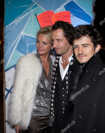 British actor Orlando Bloom, photographer Sebastian Copeland and Caroline Doerwald, from right, prior to a reception of the Cinema for Peace Foundation, in Berlin, Germany