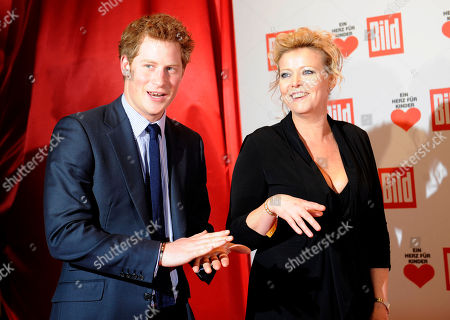 """Prince Harry Britain's Prince Harry is accompanied by Marion Horn, right, chief editor of Bild newspaper, as he arrives for the German charity event """"Ein Herz fuer Kinder"""" ( A heart for children) in Berlin . The Prince receives a Golden Heart award in recognition of his humanitarian work. The German charity organisation Ein Herz fuer Kinder is Germany's biggest television fundraising gala"""