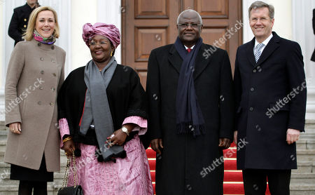 German President Christian Wulff, right, his wife Bettina Wulff, left, welcome the President of Sierra Leone, Ernest Bai Koroma, second right, and his wife Sia Nyama Koroma, second left, at the Bellevue Palace in Berlin, Germany
