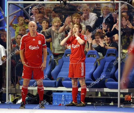 Liverpool players Phil Neal and Euan Blair