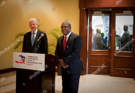 Bill Clinton, Jean-Max Bellerive Former President and special U.N. envoy to Haiti, Bill Clinton, left, and Haiti's Prime Minister Jean-Max Bellerive give a press conference after a meeting by the Interim Haiti Recovery Commission in Port-au-Prince, Haiti, . Clinton is on a one-day visit to Haiti to discuss the future of reconstruction efforts with two presidential candidates who will compete in a March 20 runoff