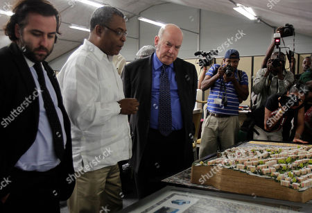 Jose Miguel Insulza, Secretary General of the Organization of American States, center, and Haiti Prime Minister Jean-Max Bellerive, second from left, look at a model of a reconstructed Fort Nationale, a neighborhood that was destroyed by last year's earthquake, in Port-au-Prince, Haiti