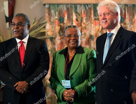 Bill Clinton, Jean-Max Bellerive, Mirlande Manigat Former President and UN special envoy to Haiti Bill Clinton, right, Haiti's Prime Minister Jean-Max Bellerive, left, and presidential candidate Mirlande Maniga pose for pictures during a meeting in Port-au-Prince, Haiti