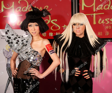 Stock Image of Vincy Chan Hong Kong singer Vincy Chan, left, poses with a wax figure of international star Lady Gaga unveiled at Hong Kong Madame Tussauds in Hong Kong