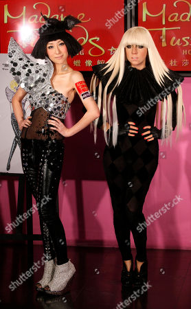 Stock Image of Vincy Chan Hong Kong singer Vincy Chan, left, poses with a newly launched wax figure of international star Lady Gaga in Hong Kong Madame Tussauds in Hong Kong