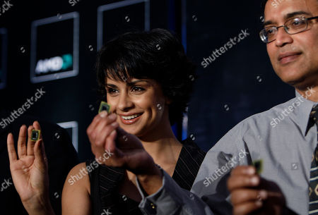 Gul Panag, Manju Hegde Bollywood actress Gul Panag, left, and Advanced Micro Devices Inc. Corporate Vice President Manju Hegde hold the AMD's accelerated processing unit (APU) chips during its launch, in Bangalore, India, . Chip-maker AMD Tuesday announced the launch of a new chipset that offers higher computing speed and better graphics