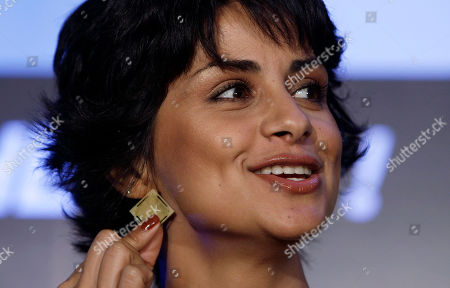Gul Panag Bollywood actress Gul Panag holds Advanced Micro Devices Inc.'s accelerated processing unit (APU) chip next to her ear during its launch, in Bangalore, India, . Chip-maker AMD Tuesday announced the launch of a new chipset that offers higher computing speed and better graphics
