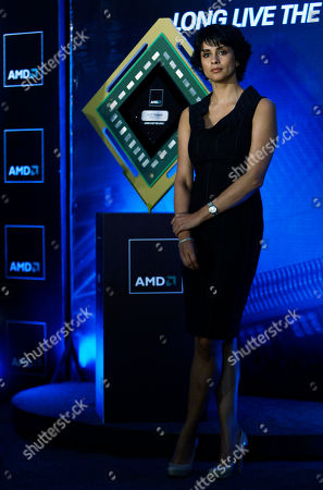 Gul Panag Bollywood actress Gul Panag stands next to a model of Advanced Micro Devices Inc.'s accelerated processing unit (APU) chip during its launch, in Bangalore, India, . Chip-maker AMD Tuesday announced the launch of a new chipset that offers higher computing speed and better graphics
