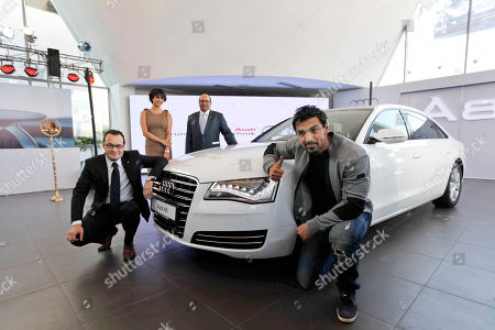 John Abraham, Michael Perschke, Gul Panag, Raghav Chandra From right to left, Bollywood actor John Abraham, Audi India head Michael Perschke, Bollywood actress Gul Panag, and Audi Delhi Managing Director Raghav Chandra pose for photographs at a press conference to unveil the Audi A8 L at the Audi India's largest showroom in the country, in New Delhi, India, . The Audi A8L 4.2 FSI model will be available for 89,00,000 Indian Rupees (approximately US$ 1,95,047), ex-showroom price Delhi