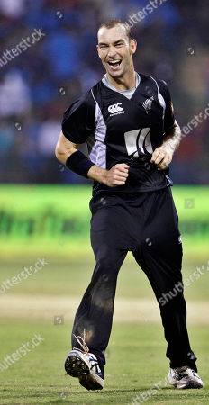 Andy McKay New Zealand's Andy McKay celebrates the dismissal of India's Virat Kohli, not seen, during their fourth one day international cricket match, in Bangalore, India, . India leads the series 3-0