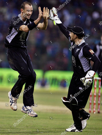 Andy McKay, Brendon McCullum New Zealand's Andy McKay, left, celebrates with teammate Brendon McCullum the dismissal of India's Virat Kohli, not seen, during their fourth one day international cricket match, in Bangalore, India, . India leads the series 3-0