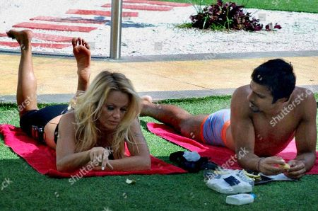 """Pamela Anderson Former """"Baywatch"""" star Pamela Anderson, left, and Indian actor Ashmit Patel talk on the set of the Indian reality television show """"Big Boss"""" in Mumbai, India"""