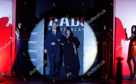 Lisa Ray Rado Vice President of Sales Olivier Cosandier, center left, walks with Rado brand ambassador actress Lisa Ray as she displays a Rado watch from the 'centrix' collection at its unveiling in New Delhi, India, . The collection starts at Rs. 34,000 (US $773