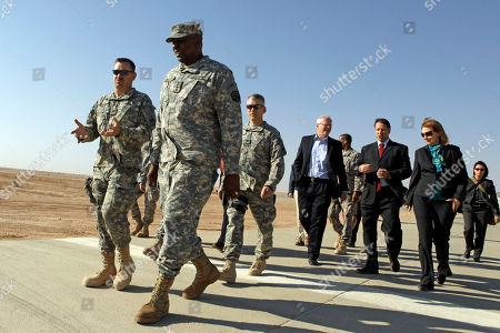 Lloyd Austin, James F. Jeffrey Gen. Lloyd Austin, the top U.S. commander in Iraq, 2nd left, along with U.S. Ambassador to Iraq James F. Jeffrey, 4th from left, walk with U.S. officers and State Department officials during a Thanksgiving visit to Al Asad Air Base in western Iraq