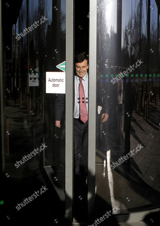 Irish Minister for Finance Brian Lenihan waves to reporters as he leaves the RTE televison studios in Dublin, Ireland, . Lenihan, a cabinet member said that he would support Irish Prime Minister Brian Cowen in the crucial vote later in the day