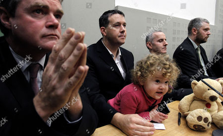 Left to Right: Senator Mark Dearey, Daisy Gogarty, 18-months in the arms of her father Green Party TD Paul Gogarty, Ciaran Cuffe TD, senator Neil O'Brolchain during a green party press conference were John Gormley, Green Party leader and Environment Minister, unseen, called for a general election at Leinster House, Dublin, Ireland, . The junior member of the coalition, the Green Party, stunned Cowen and his Fianna Fail party by announcing Monday they want parliament dissolved in January for an early election. Ireland's banks will be pruned down, merged or sold as part of a massive EU-IMF bailout taking shape, the government said Monday as a shellshocked nation came to grips with its failure to protect and revive its banks