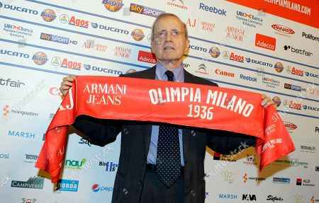 US coach Dan Peterson poses with an Olimpia Milano scarf prior to a news conference in Milan, . Peterson signed as new coach of the Milan's basketball team Armani Jeans. At the age of 75 Dan Peterson will replace Piero Bucchi and return to the Milan team where he was coach in the 1980's