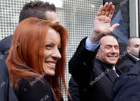 Silvio Berlusconi, Michela Brambilla Italian Premier Silvio Berlusconi greets supporters as Italy tourism minister Michela Vittoria Brambilla smiles beside him, in downtown Milan, Italy, . The 74-year-old leader faces a no-confidence vote next week that will determine the fate of his government. Just weeks ago, it appeared Berlusconi had little chance of winning after his biggest ally withdrew his backing, effectively depriving him of the votes he would need to survive Tuesday's challenge