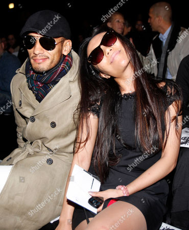 Chinese jevelry designer Bao Bao Wan, right is flanked by former Japanese soccer star Hidetoshi Nakata as they attend the Dsquared2 men's Fall-Winter 2011/2012 fashion show, part of the Milan Fashion Week, unveiled in Milan, Italy