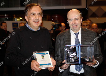 Sergio Marchionne, Raffaele Jerusalmi Fiat CEO Sergio Marchionne, left, poses with CEO of the Milan's stock exchange Raffaele Jerusalmi at the stock exchange building in Milan, . Fiat split its industrial vehicle business from its automaking unit on Monday in a move aimed at giving birth to a global automative company with Chrysler LLC. The historic shift was complete with Fiat Industrial's debut on the Milan Stock Exchange. It opened at euro9 ($12.03). Fiat Industrial includes CNH agriculture and construction vehicles and Iveco trucks