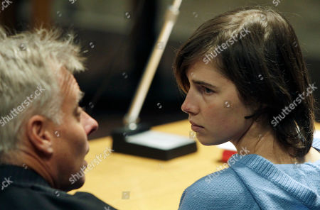 US murder suspect Amanda Knox, right, talks to her lawyer Carlo Della Vedova during a hearing in her appeals trial, in Perugia's courthouse, Italy, . Amanda Knox returned to court in Italy on Wednesday for the start of her appeals trial, about a year after the American student was convicted of killing her British roommate in a case that drew global attention. Knox was escorted by a policewoman into the same Perugia courtroom where the first trial was held. The 23-year-old was convicted in December of sexually assaulting and murdering Meredith Kercher, and sentenced to 26 years in prison