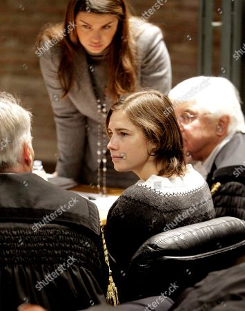 Amanda Knox Amanda Knox, talks to her lawyer Carlo Della Vedova, left, as other lawyers Maria del Grosso, top, and Luciano Ghirga look, during a hearing in her appeals trial, at Perugia's courthouse, Italy, . The 23-year-old American student was convicted of murder and sexual assault in the 2007 death of her flatmate, British student Meredith Kercher, and sentenced to 26 years in prison