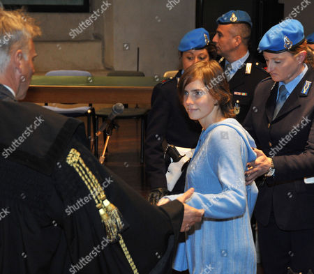 Stock Photo of Amanda Knox of the US, centre, escorted by penitentiary guards, with her lawyer Carlo Della Vedova, left, arrives for a hearing for her appeals trial, in Perugia's courthouse, Italy, . Amanda Knox returned to court in Italy on Wednesday for the start of her appeals trial, about a year after the American student was convicted of killing her British roommate in a case that drew global attention. Knox was escorted by a policewoman into the same Perugia courtroom where the first trial was held. The 23-year-old was convicted in December of sexually assaulting and murdering Meredith Kercher, and sentenced to 26 years in prison