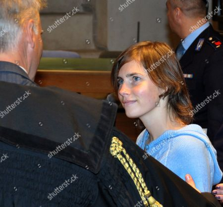 Stock Picture of Amanda Knox of the US, right, with her lawyer Carlo Della Vedova, arrives for a hearing for her appeals trial, in Perugia's courthouse, Italy, . Amanda Knox returned to court in Italy on Wednesday for the start of her appeals trial, about a year after the American student was convicted of killing her British roommate in a case that drew global attention. Knox was escorted by a policewoman into the same Perugia courtroom where the first trial was held. The 23-year-old was convicted in December of sexually assaulting and murdering Meredith Kercher, and sentenced to 26 years in prison