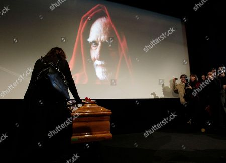 Stock Picture of Mario Monicelli A woman touches the coffin of Italian Director Mario Monicelli in Rome, . Deftly mixing comedy with tragedy, director Mario Monicelli laid bare Italy's flaws and sins for a half-century on the screen. In his final script of his own life, he chose a dramatic ending: Plunging off the fifth-floor balcony of a Rome hospital Monday night Nov. 29, where he had been admitted several days earlier. Monicelli, 95, is being mourned as the last great master in a generation of Italian comic film directors who satirized society, along with Dino Risi and Pietro Germi