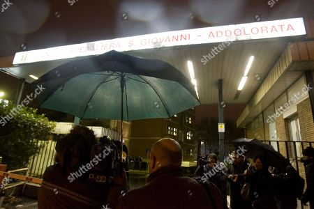 Media crowd the entrance of the San Giovanni hospital in Rome, where Italian director Mario Monicelli was hospitalized. Oscar-nominated director Mario Monicelli has died in Rome Monday, Nov. 29, 2010, after jumping from a fifth-story hospital window. He was 95