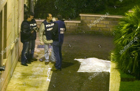 Forensic police stand by the sheet covering the body of Italian director Mario Monicelli at the San Giovanni hospital in Rome, . Oscar-nominated director Mario Monicelli died in Rome Monday, Nov. 29, 2010, after jumping from a fifth-story hospital window. He was 95