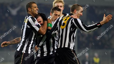 Simone Pepe, Felipe Melo, Girgio Chiellini Juventus' Simone Pepe, center, is cheered by teammates Giorgio Chiellini, right, and Felipe Melo, of Brazil, after scoring during the Italian Cup soccer match between Juventus and Catania in Turin, Italy