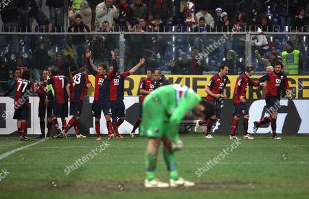 Genoa players celebrate after scoring a goal while Sampdoria goalkeeper Gianluca Curci reacts in foreground, during a Serie A soccer match between Sampdoria and Genoa CFC at the Genoa Luigi Ferraris stadium, Italy
