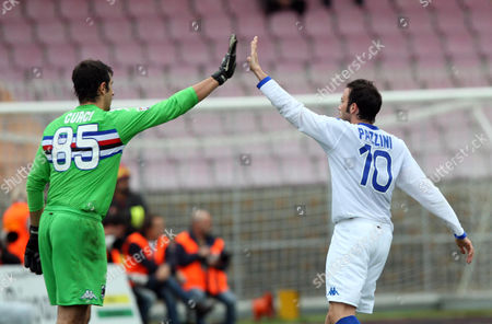 Sampdoria's goalkeeper Gianluca Curci, left, and Giampaolo Pazzini celebrate after Pazzini scored during a Serie A soccer match between Lecce and Sampdoria, in Lecce, Italy